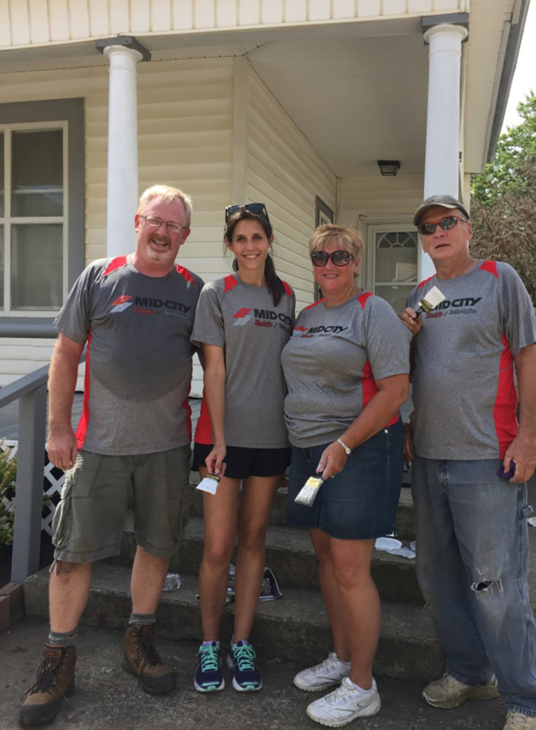 Mid-City Electric partners with Turner Construction and several other industry firms to beautify homes near Nationwide Children's Hospital